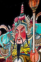 Huge gods have been traditionally painted onto the massive doors of the Chen Family Ancestral Temple in Guangzhou.