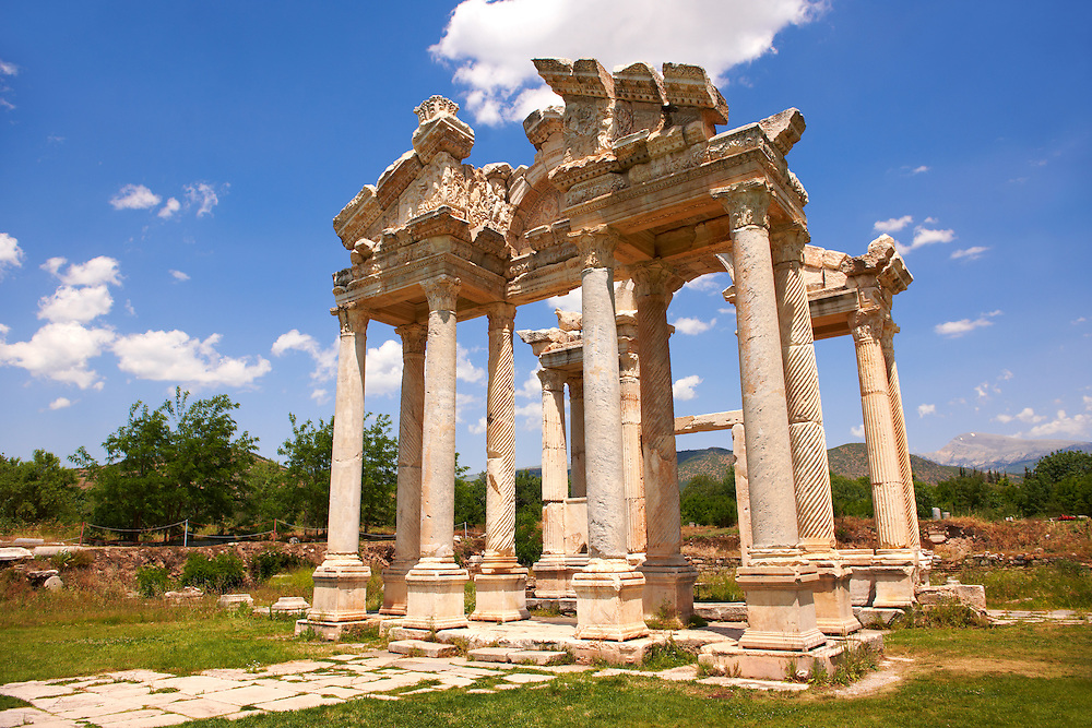 """Picture of the double Tetrapylon Gate, Aphrodisias, Turkey. A tetrapylon (Greek: Τετράπυλον, """"four gates"""") is an ancient type of Roman monument of cubic shape, with a gate on each of the four sides: generally it was built on a crossroads. stock photos & photo art prints. 3"""
