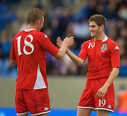 REYKJAVIK, ICELAND - Wednesday, May 28, 2008: Wales' goalscorer Ched Evans celebrates with fellow debutante Jack Collison against Iceland during the international friendly match at the Laugardalsvollur Stadium. (Photo by David Rawcliffe/Propaganda)