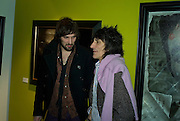 SERGIO PIZZORNO OF KASABIAN  AND RONNIE WOOD , Ideas And Idols - private view of work by Paul Karslake.<br />Scream, 34 Bruton Street, London, W1, 6.30-8.30pm<br />21 February 2008.  *** Local Caption *** -DO NOT ARCHIVE-© Copyright Photograph by Dafydd Jones. 248 Clapham Rd. London SW9 0PZ. Tel 0207 820 0771. www.dafjones.com.
