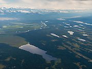 Aerial view of the Alaska Range, Swan Lake (foreground) and the Tokositna River near Talkeetna, Alaska.