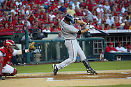 CHICAGO - OCTOBER 14:  Paul Konerko #14 of the Chicago White Sox hits a two run home run off of John Lackey in the first inning during Game 3 of the American League Championship Series against the Los Angeles Angels of Anaheim at Angels Stadium on October 14, 2005 in Anaheim, California.  The White Sox defeated the Angels 5-2.