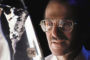 Human Genome Project: Columbia University. Charles Cantor, American biologist, photographed in a laboratory at Columbia University, New York, in May 1989. Cantor's area of research is human genetics. With colleagues at Columbia, he has contributed to work on the human genome project, an ambitious plant to construct a complete biochemical document detailing every gene expressed on each of the 23 pairs of human chromosomes. MODEL RELEASED (1989).