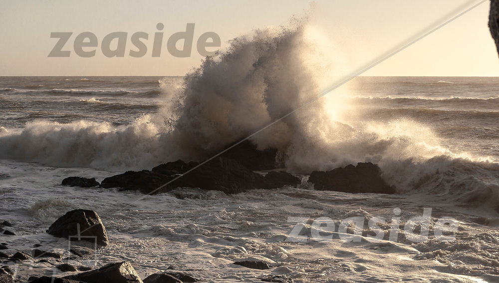 Huge swell crashes into the cliffs along the coastal stretch of the Heaphy Track, Kahurangi.