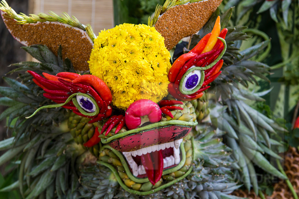 Close-up of dragon head made of fruit, flowers and vegetables, Ho Chi Minh City, Vietnam, Southeast Asia
