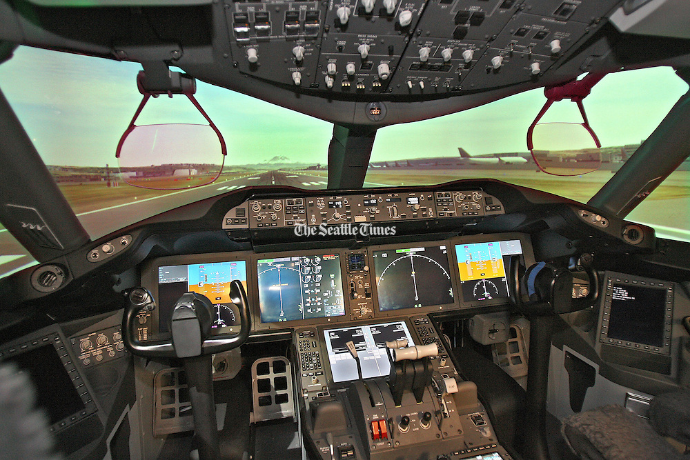 A 787 instrument panel flight simulator shows the plane taking off from Boeing Field in Seattle. Mount Rainier is in the background. This simulator is at Boeing Systems Labs in Seattle. (Mike Siegel / The Seattle Times)