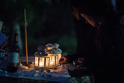 20 April 2019, Jerusalem: Congregants light candles on the altar, as Easter Sunday sees a sunrise service at Jabal Allah (God's Mountain) on the Mount of Olives in Jerusalem, held by the Lutheran Church of the Redeemer (English-speaking congregation).