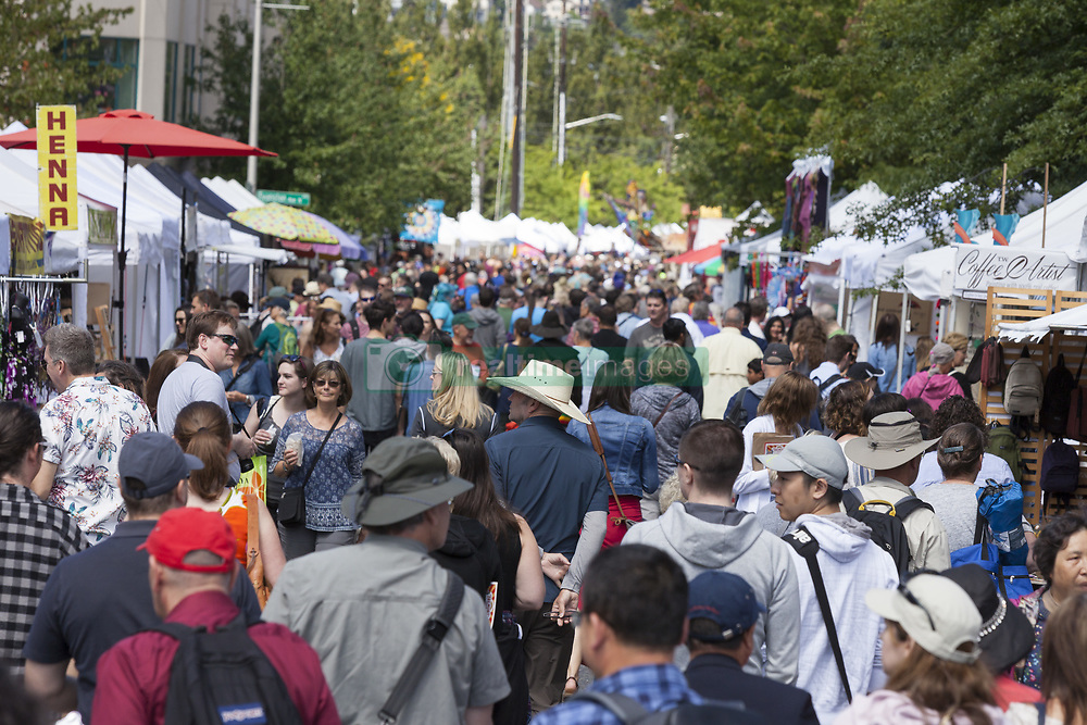 June 16, 2018 - Seattle, Washington, United States - Seattle, Washington: Thousands gather at the Fremont Fair Craft Market. The beloved neighborhood street festival takes place during the iconic Fremont Solstice Parade put on by the Fremont Arts Council. The annual craft market benefits the Fremont Chamber of Commerce, a non-profit organization that supporting public art and promotes business, and education opportunities in Fremont. (Credit Image: © Paul Gordon via ZUMA Wire)