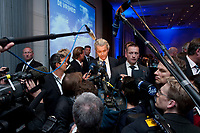 """02 OCT 2010, BERLIN/GERMANY:<br /> Geert Wilders (M), Vorsitzender Partij voor de Vrijheid Niederlande, im Gespraech mit Journalisten und umringt von Fotografen und Kameraleuten, nach der Rede von Wilders, Veranstaltung """"Islam und Integration"""", Hotel Berlin<br /> IMAGE: 20101002-01-071<br /> KEYWORDS: Mikrofon, microphone, Kamera, Camera"""