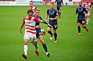 Doncaster Rovers defender Niall Mason (2) and Luton Town forward Harry Cornick (14) tussle during the EFL Sky Bet League 1 match between Doncaster Rovers and Luton Town at the Keepmoat Stadium, Doncaster, England on 8 September 2018.