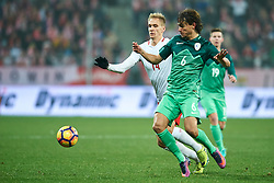 Wroclaw, Poland - 2016 November 14: Rene Krhin of Slovenia fights for the ball with Lukasz Teodorczyk of Poland during Poland v Slovenia - International Friendly Soccer Match at Municipal Stadium on November 14, 2016 in Wroclaw, Poland.<br /> <br /> Adam Nurkiewicz declares that he has no rights to the image of people at the photographs of his authorship.<br /> <br /> Picture also available in RAW (NEF) or TIFF format on special request.<br /> <br /> Any editorial, commercial or promotional use requires written permission from the author of image.<br /> <br /> Mandatory credit:<br /> Photo by © Adam Nurkiewicz / Mediasport