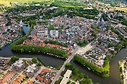 Nederland, Utrecht, Woerden, 22-05-2011; het centrum van Woerden van oudsher legerplaats en vesting, herkenbaar aan de stervorm. Rechts het Defensie-eiland met het Kasteel van Woerde en loodsen van het voormalige Centraal Magazijn van Kleding en Uitrusting van de landmacht. In het centrum Molen de Windhond en de  Petruskerk..Center of Woerden, traditional army town and fortress, identifiable by the star shape. Right Defence Island with Castle Woerden and barracks of the former Central Warehouse for Clothing and Equipment of the army..luchtfoto (toeslag); aerial photo (additional fee required);.foto Siebe Swart / photo Siebe Swart