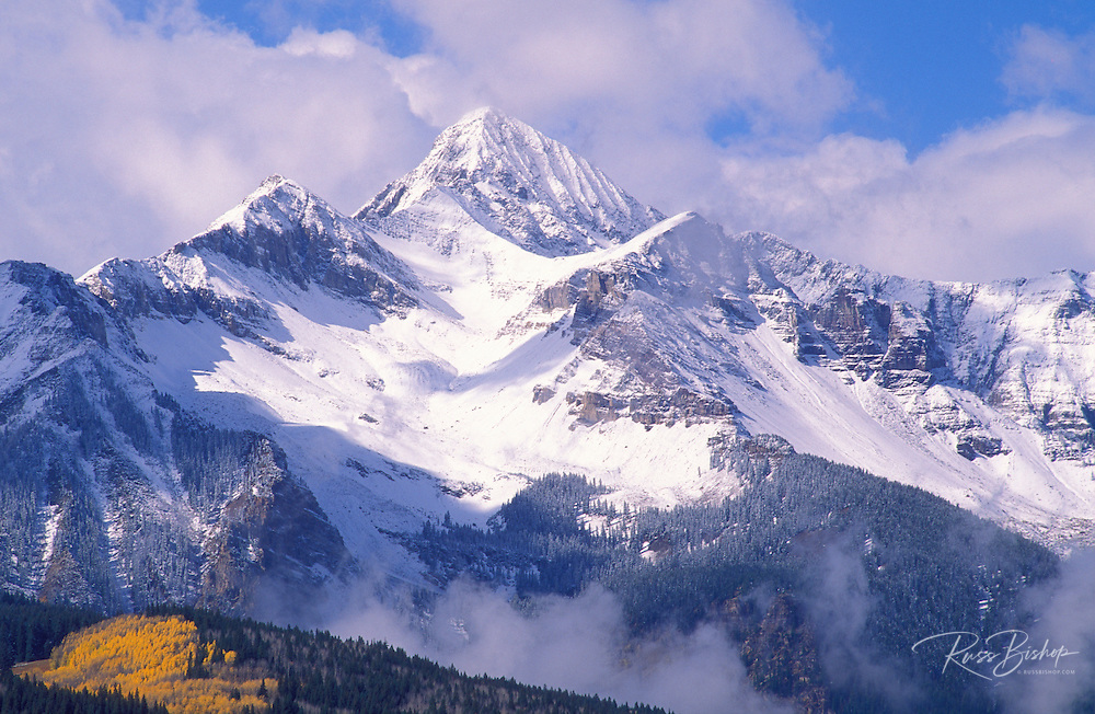 Fall aspens and fresh powder on Wilson Peak, San Juan Mountains, Uncompahgre National Forest, Colorado USA