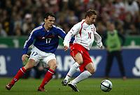 Fotball<br /> Privatlandskamp<br /> Frankrike v Polen<br /> 17. november 2004<br /> Foto: Digitalsport<br /> NORWAY ONLY<br /> TOMASZ FRANKOWSKI (POL) / SEBASTIEN SQUILLACI (FRA)