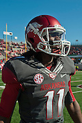 Oct 27, 2012; Little Rock, AR, USA; Arkansas Razorback wide receiver Cobi Hamilton (11) walks onto the field before a game against the Ole Miss Rebels at War Memorial Stadium. Ole Miss defeated Arkansas 30-27. Mandatory Credit: Beth Hall-US PRESSWIRE