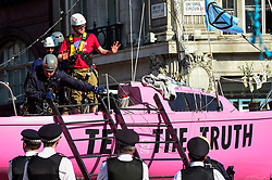"""© Licensed to London News Pictures. 19/04/2019. LONDON, UK. Police officers remove the last activist from the pink boat at Oxford Circus during """"London: International Rebellion"""", on day five of a protest organised by Extinction Rebellion.  Protesters are demanding that governments take action against climate change.  Police have issued a section 14 order requiring protesters to convene at Marble Arch only so that the protest can continue.  Photo credit: Stephen Chung/LNP"""
