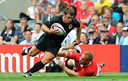 Photo © SPORTZPICS / SECONDS LEFT IMAGES 2011 - Rugby Union - Investic - World Cup warm up game - England V Wales - 06/08/11 - England's Lee Mears.beats a tackle by Wales' Luke Charteris to open an attack in the second half - at Twickenham Stadium UK - All rights reserved