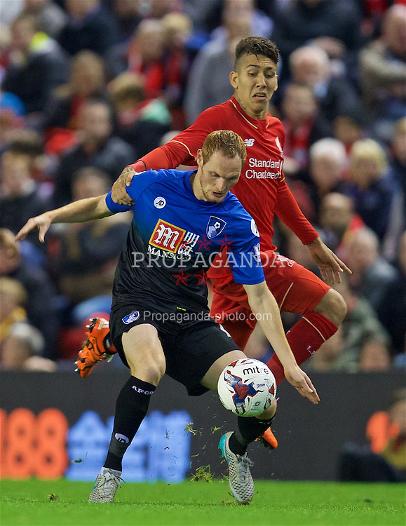 LIVERPOOL, ENGLAND - Wednesday, October 28, 2015: AFC Bournemouth's Shaun MacDonald in action against Liverpool's Roberto Firmino during the Football League Cup 4th Round match at Anfield. (Pic by David Rawcliffe/Propaganda)