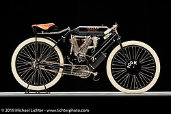 "1908 Indian Twin Torpedo Tank Racer, on loan from the Jill and John Parham Collection at the National Motorcycle Museum. In 1907 Teddy Hastings, a New York racer, went to England, raced a stock Indian V-twin and won the 1000 Mile Reliability Trial there. In 1908 he returned and rode with factory support on a machine similar to this one. By 1908 they offered a ""production racer"" to the public, allowing competitors outside the Indian factory to compete and promote the Indian brand. Photographed by Michael Lichter in Sturgis, SD. July 31, 2019. ©2019 Michael Lichter"