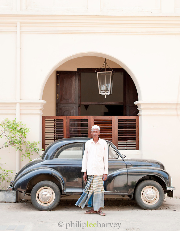 Local man in front of an old car, Galle, Sri Lanka