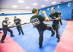 Students kicking and attacking under the area of the hoop, Stef Noij, KMG Instructor from the Institute Krav Maga Netherlands, at the IKMS G Level Programme seminar today at the Scottish Martial Arts Centre, Alloa.