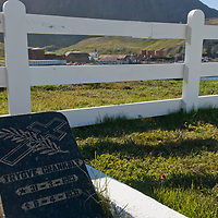 The gravestone of a young whaler, or maybe a whaler's child, lies in the cemetary at Grytviken, by  Cumberland Bay, South Georgia, Antarctica.