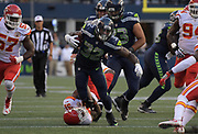Aug 25, 2017; Seattle, WA, USA; Seattle Seahawks running back Chris Carson (32) is defended by Kansas City Chiefs cornerback DeVante Bausby (31) during a NFL football game at CenturyLink Field. The Seahawks defeated the Chiefs 26-13.