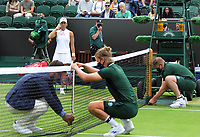 Tennis - 2021 All England Championships - Week One - Day Six (Saturday) - Wimbledon<br /> Ladies Singles<br /> Angelique Kerber v Aliaksandra Sasnovich<br /> <br /> Angelic Kerber of Germany waits for the net to go back up after the rain delay<br /> <br /> <br /> CreditCOLORSPORT/Andrew Cowie