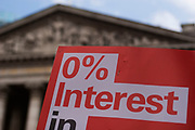 0% Interest placard. Protesters gather to deomontstrate against various issues outside the Bank of England in the heart of the City of London. Issues such as anti climate change, capitalism and those against the credit crisis were the main points of the day. Bankers being a particular target of protest.