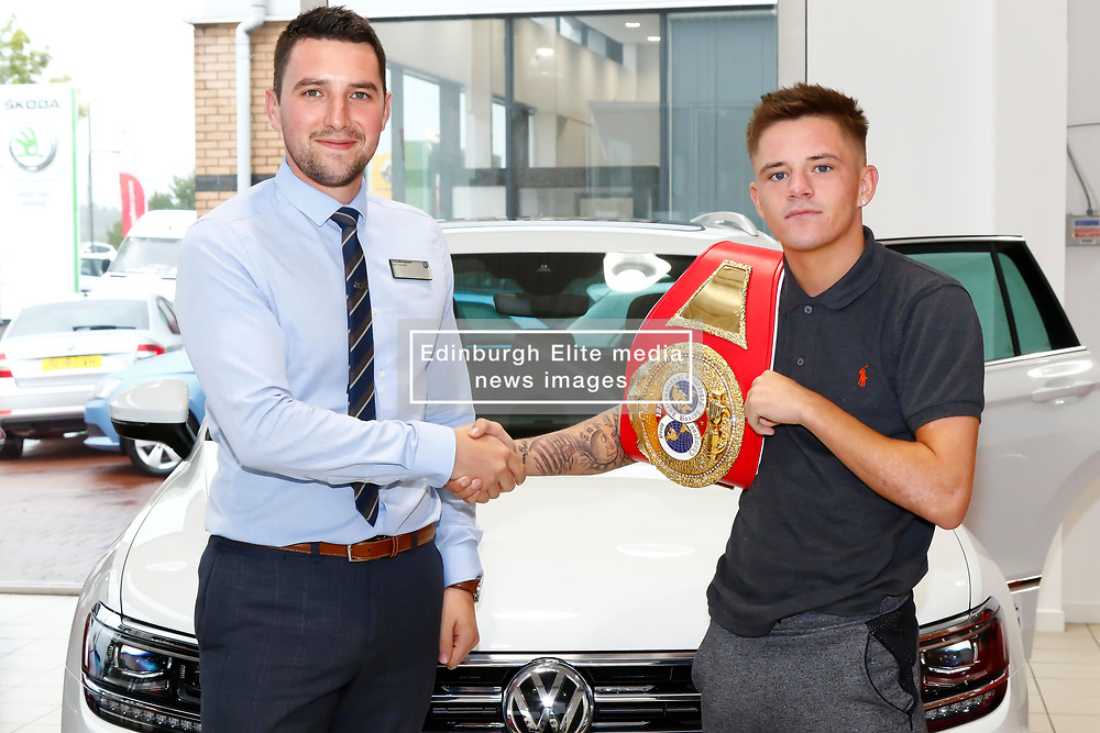 Pictured: IBF Youth Bantamweight Champion Lee McGregor with  Greg Montignani (VW Specialist Cars Fife) after agreeing a new deal<br /> Colin Poultney | EEm 01/08/2018