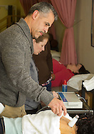 Middletown, New York  - A student in the physical therapy assistant program demonstrates ultrasound therapy on another student during an open house for the program at SUNY Orange on  Nov. 6, 2013.