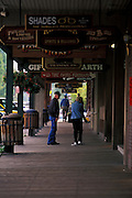 Visitors browse shops on wooden walkway in the Shopping district surrounding town Square, Jackson, Wyoming. ..Subject photograph(s) are copyright Edward McCain. All rights are reserved except those specifically granted by Edward McCain in writing prior to publication...McCain Photography.211 S 4th Avenue.Tucson, AZ 85701-2103.(520) 623-1998.mobile: (520) 990-0999.fax: (520) 623-1190.http://www.mccainphoto.com.edward@mccainphoto.com.