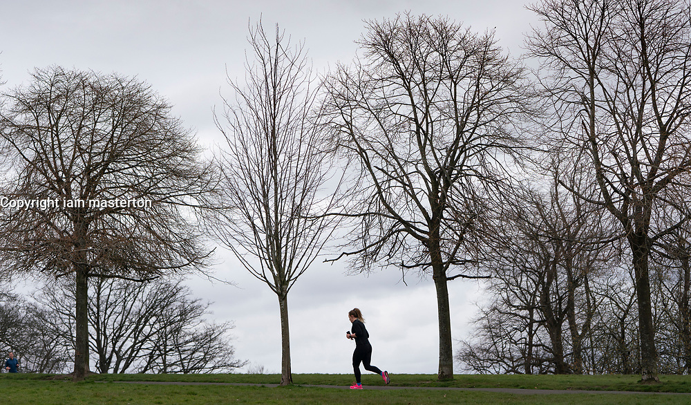 Glasgow, Scotland, UK. 3 April, 2020. Images from the southside of Glasgow at the end of the second week of Coronavirus lockdown. Pictured woman running alone in Queens Park.  Iain Masterton/Alamy Live News