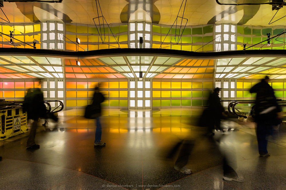 """Michael Hayden's neon installation """"Sky's the Limit"""" walkway at Chicago's O'hare Airport"""