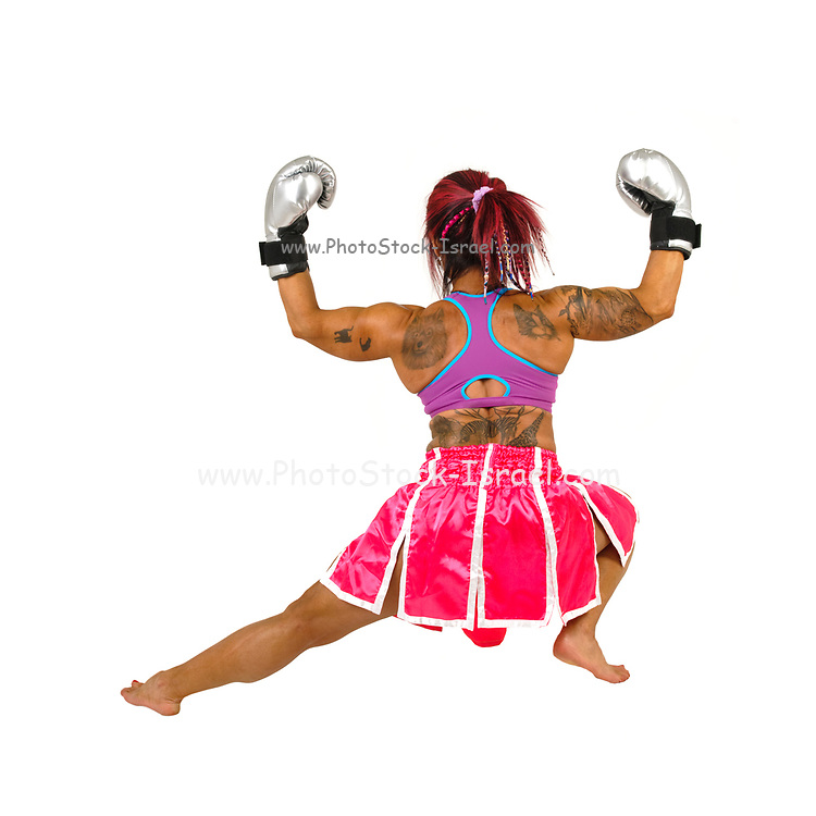 Female boxer flexes her muscles