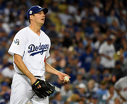 October 25, 2017 - Los Angeles, California, U.S. - Los Angeles Dodgers starting pitcher Rich Hill reacts after giving up a RBI single against the Houston Astros in the third inning of game two of a World Series baseball game at Dodger Stadium on Wednesday, Oct. 25, 2017 in Los Angeles. (Photo by Keith Birmingham, Pasadena Star-News/SCNG) (Credit Image: © San Gabriel Valley Tribune via ZUMA Wire)