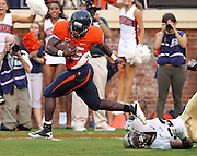 Sept. 3, 2011 - Charlottesville, Virginia - USA; Virginia Cavaliers running back Kevin Parks (25) scores a touchdown in front of William & Mary Tribe safety Jared Velasquez (33) during an NCAA football game at Scott Stadium. Virginia won 40-3. (Credit Image: © Andrew Shurtleff