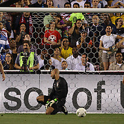 Carlos Bocanegra, (left), Tim Howard, (centre) and Fabian Johnson, USA, show their disappointment after a Brazil goal during the USA V Brazil International friendly soccer match at FedEx Field, Washington DC, USA. 30th May 2012. Photo Tim Clayton