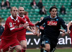 Bari (BA), 23-01-2011 ITALY - Italian Soccer Championship Day 21 - Bari VS Napoli..Pictured: Cavani (N) Belmonte (B).Photo by Giovanni Marino/OTNPhotos . Obligatory Credit