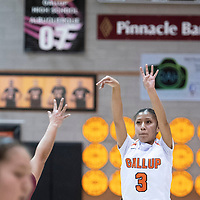 Gallup's Amanda Mitchel (3) takes a jump shot in the first quarter against Shiprock Friday night at Gallup High School.