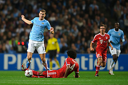 Man City Forward Edin Dzeko (BIH) is tackled by Bayern Defender Dante (BRA) during the first half of the match - Photo mandatory by-line: Rogan Thomson/JMP - Tel: Mobile: 07966 386802 - 02/10/2013 - SPORT - FOOTBALL - Etihad Stadium, Manchester - Manchester City v Bayern Munich - UEFA Champions League Group D.