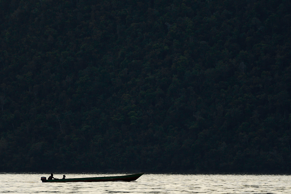 """Local boat on the Lenguru river, near Lobo village, Triton Bay, mainland New Guinea, Western Papua, Indonesian controlled New Guinea, on the Science et Images """"Expedition Papua, in the footsteps of Wallace"""", by Iris Foundation"""