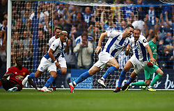Brighton & Hove Albion's Shane Duffy (centre) celebrates scoring his side's second goal of the game with team-mates