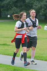 © Licensed to London News Pictures 13/08/2021. <br /> Greenwich, UK. Two runners keeping fit. A warm but cloudy day as people get out and about in Greenwich Park, London today enjoying some normality after the Coronavirus pandemic in the UK.<br /> Photo credit:Grant Falvey/LNP