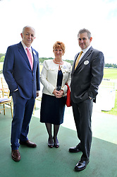 Left to right, news reporter JEREMY BOWEN and JOHN & SANDRA ANSON at Al Habtoor Royal Windsor Cup Final 2012 at Guards Polo Club, Berkshire on 24th June 2012.