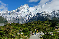 Oceania, New Zealand, Aotearoa, South Island, Mount Cook National Park, people hiking in Hooker valley