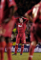 Photo: Jed Wee.<br /> Liverpool v Benfica. UEFA Champions League. 08/03/2006.<br /> <br /> Liverpool's Jamie Carragher feels the pain of defeat.