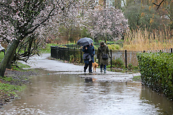 © Licensed to London News Pictures. 16/02/2020. London, UK. Women walking through the flood in Clissold Park, north London, caused by heavy rain from Storm Dennis. Photo credit: Dinendra Haria/LNP