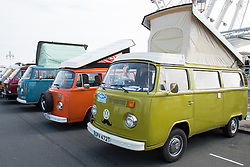 © Licensed to London News Pictures. 03/10/2015. Brighton, UK. Thousands of VW camper-van  enthusiasts come down to Brighton for the yearly Brighton Breeze 2015 event where owners of Kombis show their converted and restored VW Combi vans. Today October 3rd 2015. Photo credit : Hugo Michiels/LNP