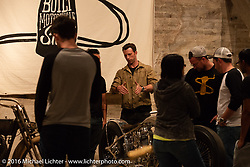 "Max Hazan talks to visitors about his amazing ""Musket"" (a custom twin engine Royal Enfield) on Saturday in the Handbuilt Motorcycle Show. Austin, TX, USA. April 9, 2016.  Photography ©2016 Michael Lichter."